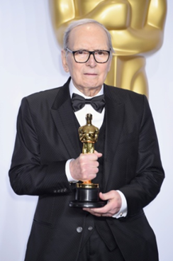 Ennio Morricone poses with his Oscar