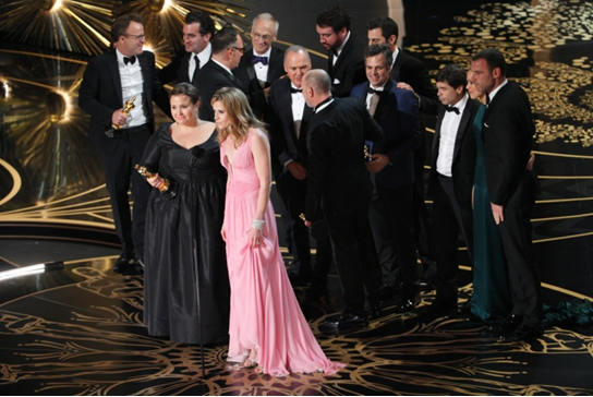The cast and crew of 'Spotlight' collect the Oscar for Best Picture